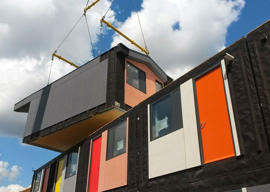 New prefabricated units are lifted onto site by a crane, creating a clean building site