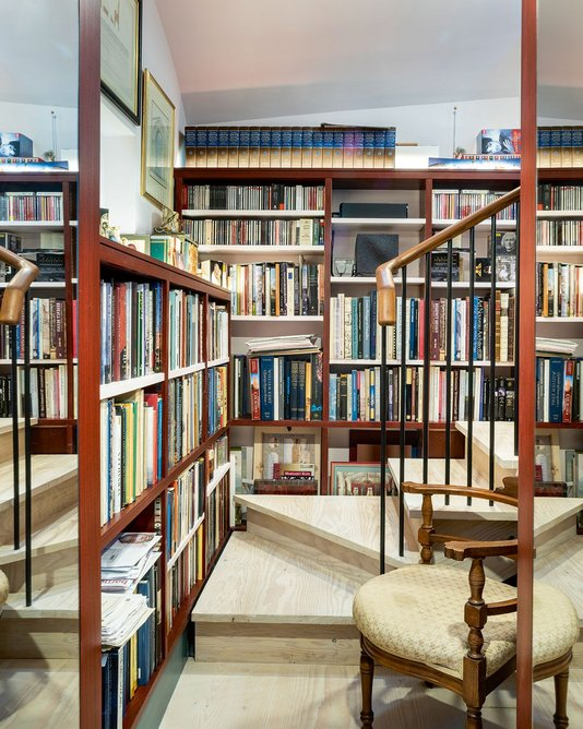 The steps down from the main basement into the former coal store, which have been joined together to make an office for one of the clients, also housing his collection of architectural historybooks..