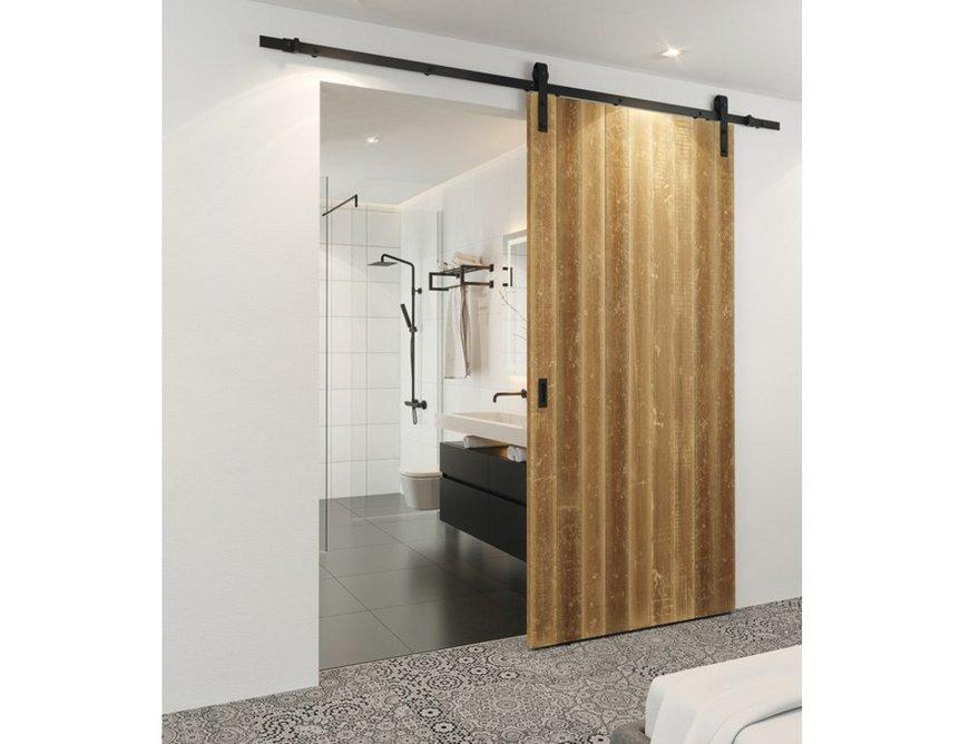 Häfele Slido D-Line rustic sliding door fitting in graphite black: A slideable solution for en-suite bathrooms.