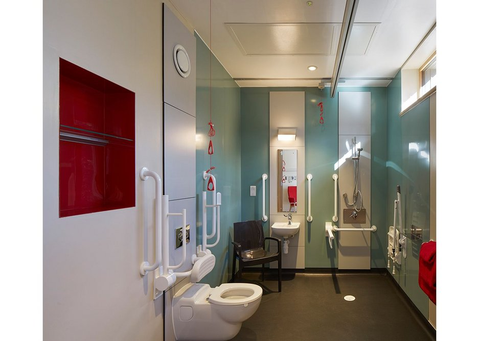 Bathroom paraphenalia can't be avoided but there are carefully considered shelves and well thought out, minimal, hoist.