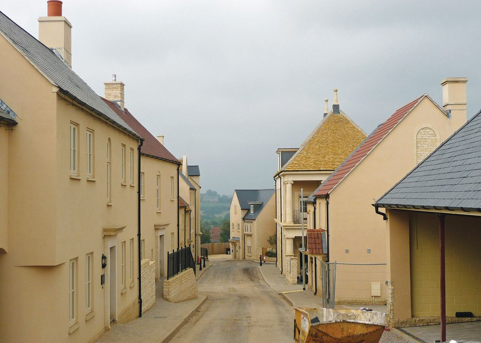 Brand new old village under construction: plainer houses line the street uphill from the costly 'market hall'