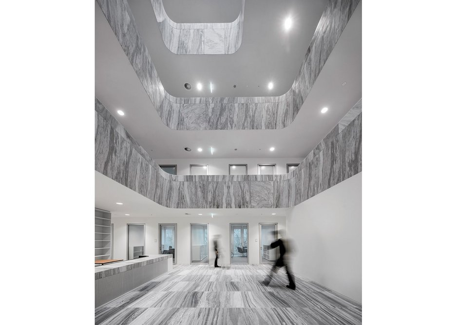 Vertical striations in the marble give civic gravitas to the Council of Judges' atrium.