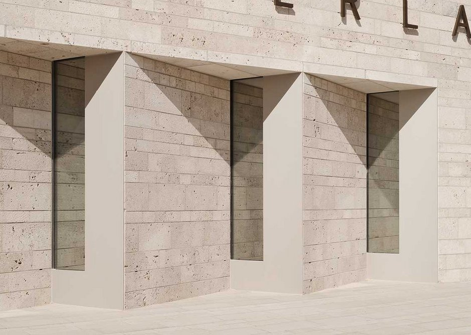Trios of glazing popping out of the wall intimate the thickness of the stone facade.
