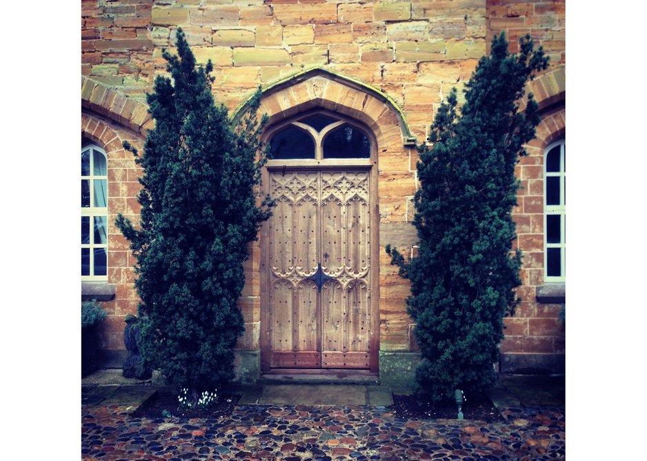 Hand carved oak gothic doors by Jack Badger Ltd.