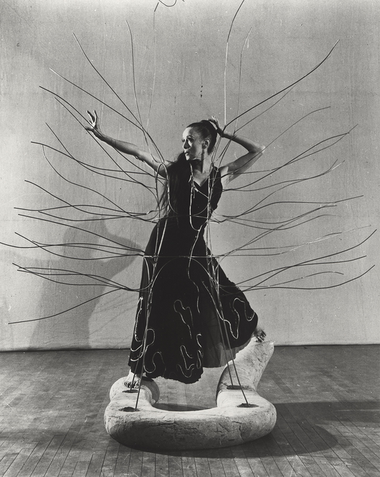 Martha Graham with Spider Dress and Serpent designed by Isamu Noguchi for Martha Graham's 'Cave of the Heart', 1946. Photograph by Cris Alexander.  The Noguchi Museum Archives, 01619 ©INFGM / ARS - DACS