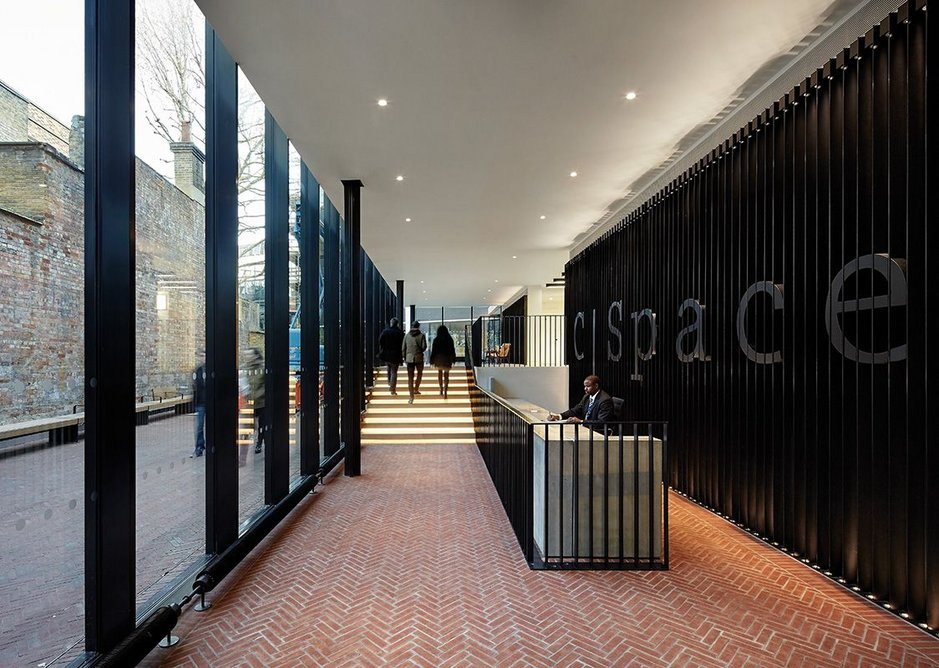 Reception with herringbone brick patterned floor that runs from outside to in.
