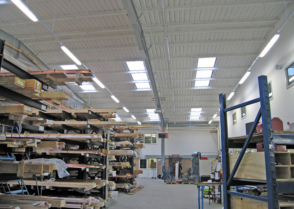 HV Wooding Factory in Hythe, Kent. SonaSpray K-13 in white was specified at 20mm to acoustically treat the corrugated ceiling for noise reverberation control. SonaSpray in white is also excellent at reflecting light, making the factory much brighter.
