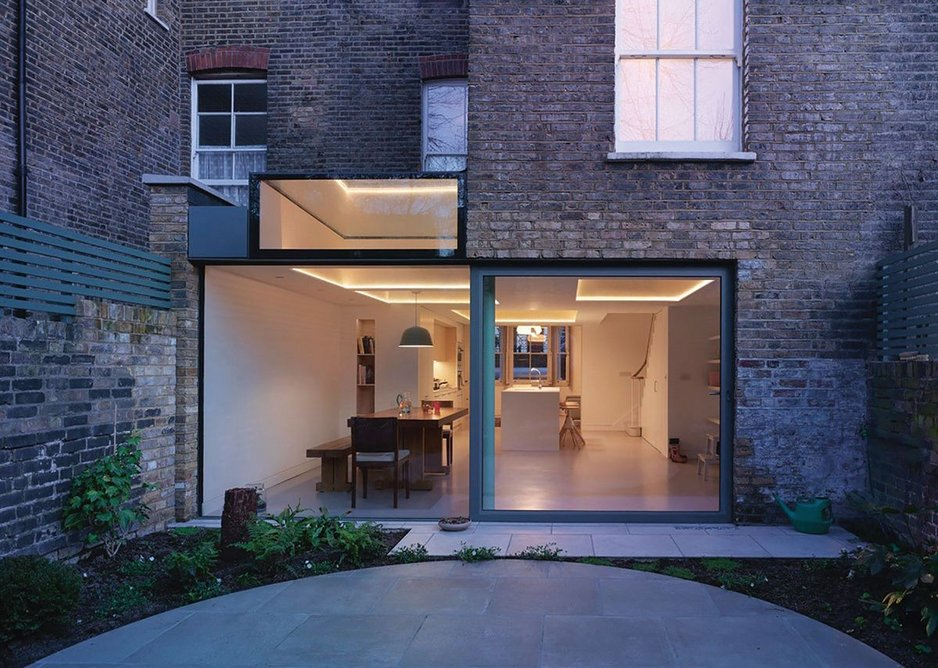 Plywood coffers push up into the ceiling for a roof lantern in this basement turned kitchen at Witherington Road, London.
