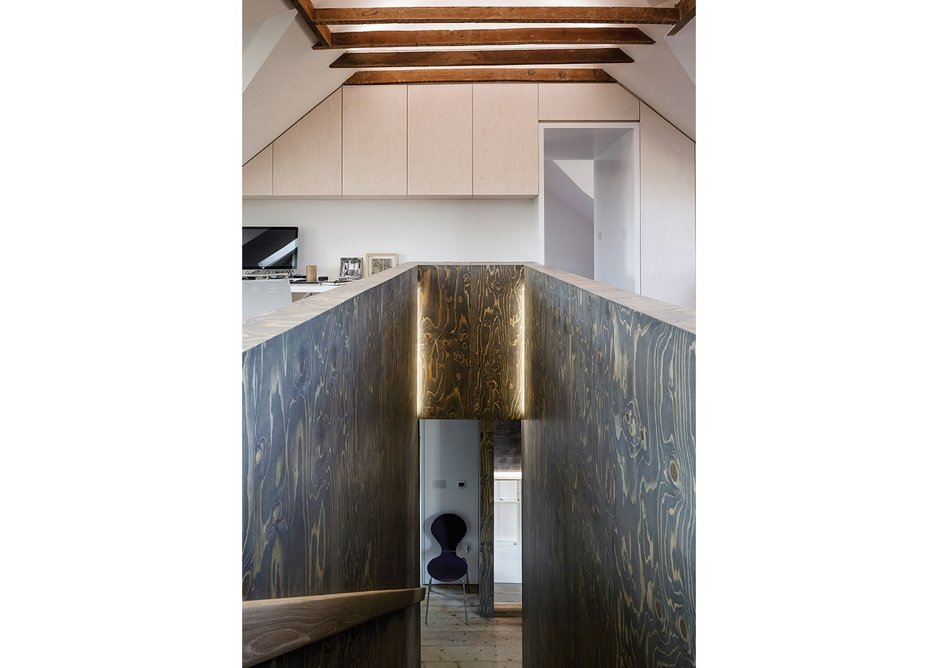 The birch ply staircase to bedroom level: humble materials, reified.
