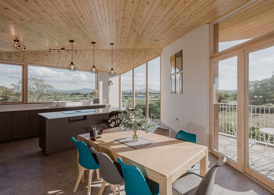 With views over the Ring of Gullion, the plan of the house at Whitecross responds to the geometries and contours of the landscape with splaying walls and an upper level living space.