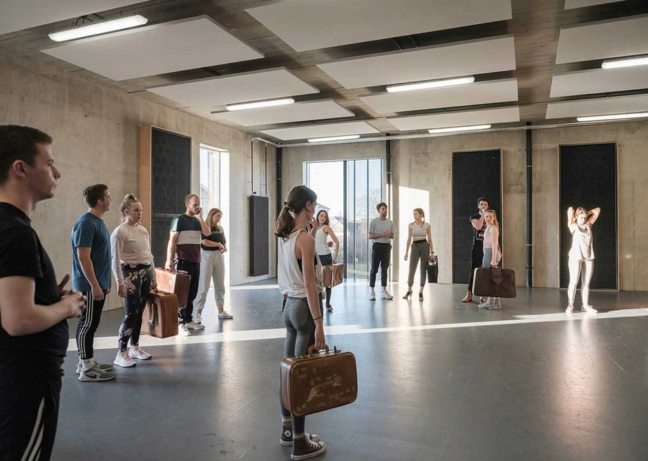 To deal with vibration, dance spaces were located on the first and second floors where beam spans were shortest.