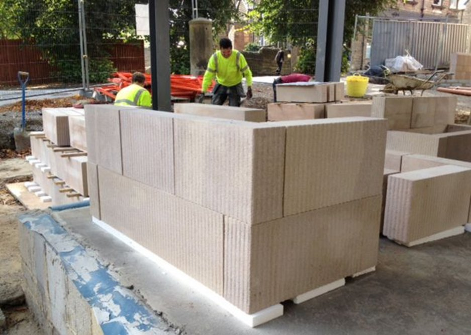 The solid locally sourced Derbyshire stonework arrives on site, ready-textured