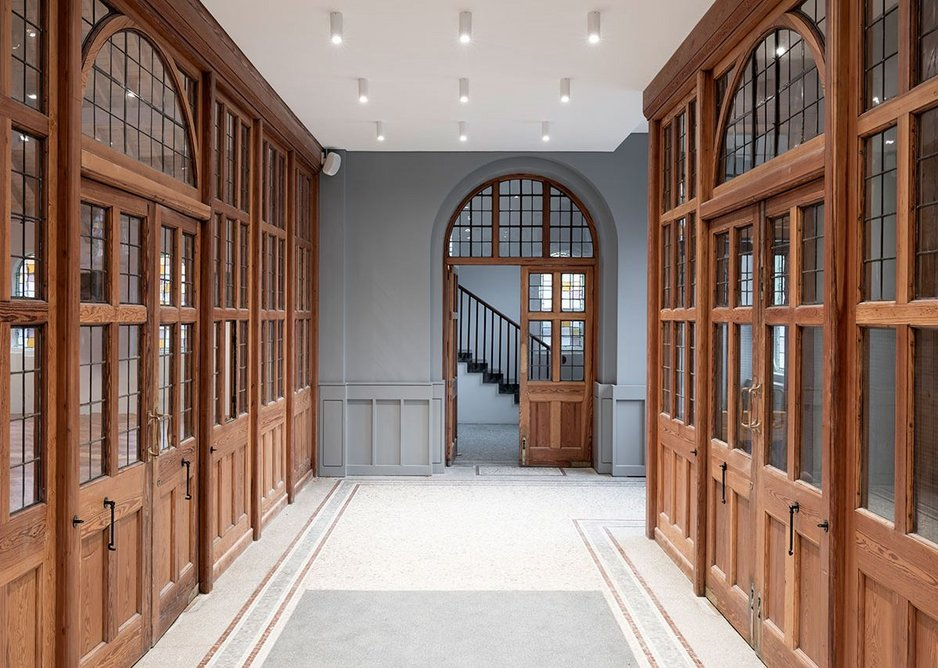 The entrance vestibule, now a calm well let space opening onto the staircase