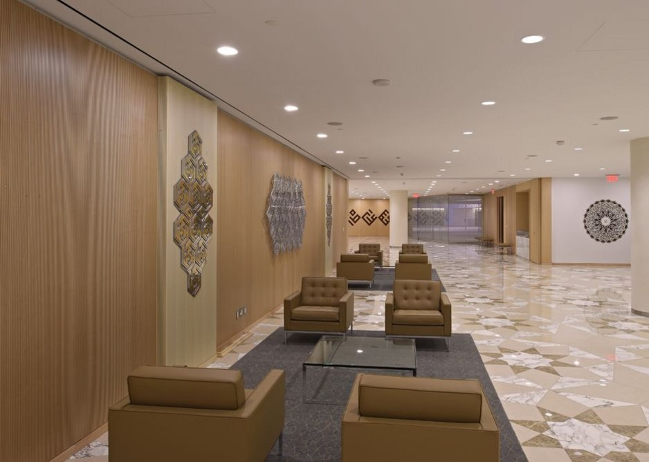 A number of exquisite art pieces are displayed in the social hall foyer, including a lattice work in a geometric pattern depicting the words Allah (Arabic for God), Muhammad and Ali intertwined and a medallion made of semi-precious stone.