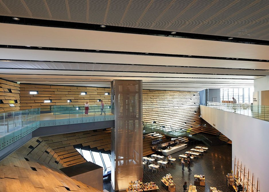 The big internal view is all about the atrium, anchored by the freestanding lift shaft and cantilevered stair. The ground floor window is angled down at the water.