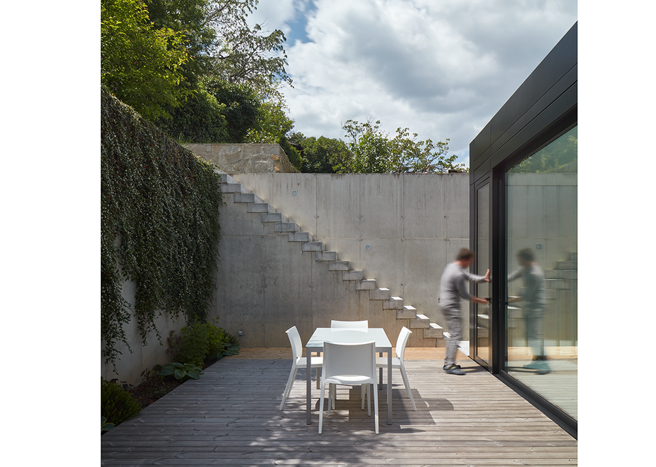 A terrace opens up at the rear of the house.