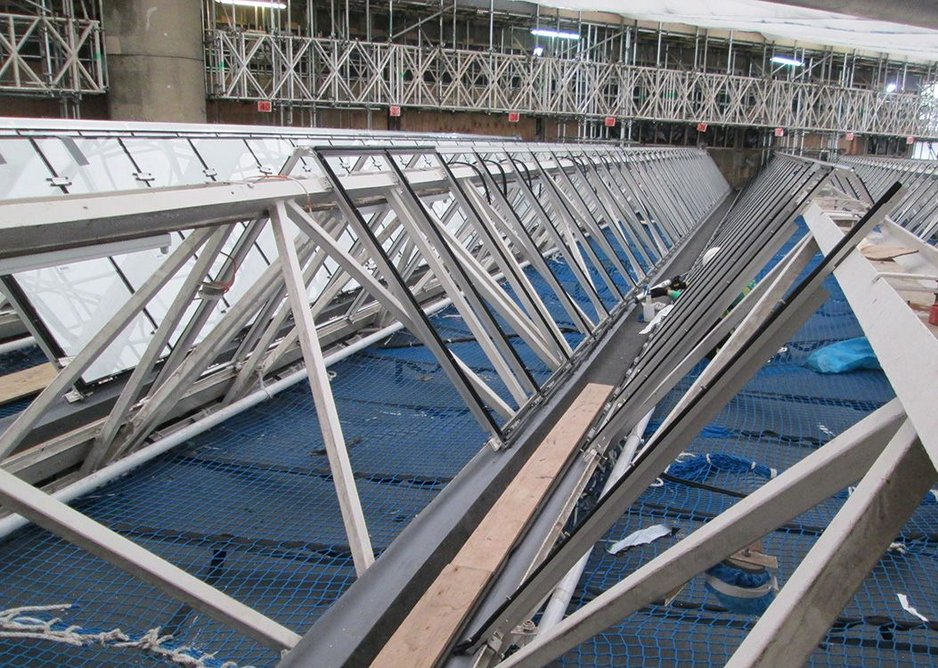 Stripped back to the steel trussed frame, new thicker aluminium sections are overlaid in preparation to receive the high performance double-glazed Ocalux units.