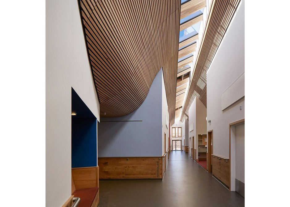 The central spine between bedrooms is a delight with the timber curving up to meet the light.