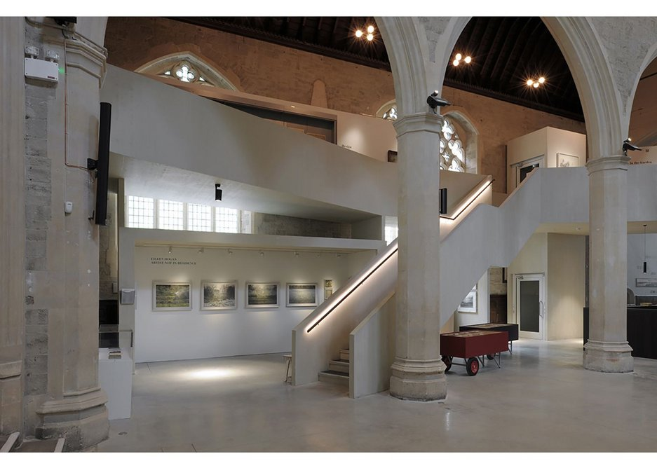 Inside the church Down Jones has drawn the two phases of galleries together with a CLT walkway.
