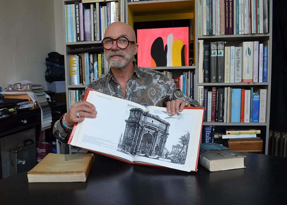 Coates with the Le Verdute di Roma open at Piranesi's 'View of the Arch of Septimius Severus'.