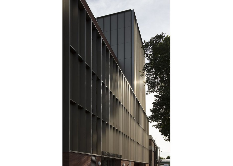 Sited on a traffic artery, the facade presents a defence for the students and staff inside.