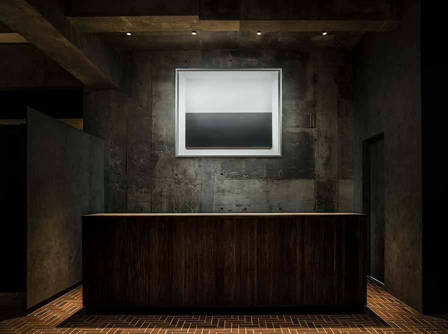 Sea of Galilee, Golan, from Hiroshi Sugimoto's famed Seascape series, hangs on a raw concrete wall above a minimalist front desk. The artist specifically selecting this photograph for the Shiroiya Hotel as it is located in landlocked Gunma Prefecture.