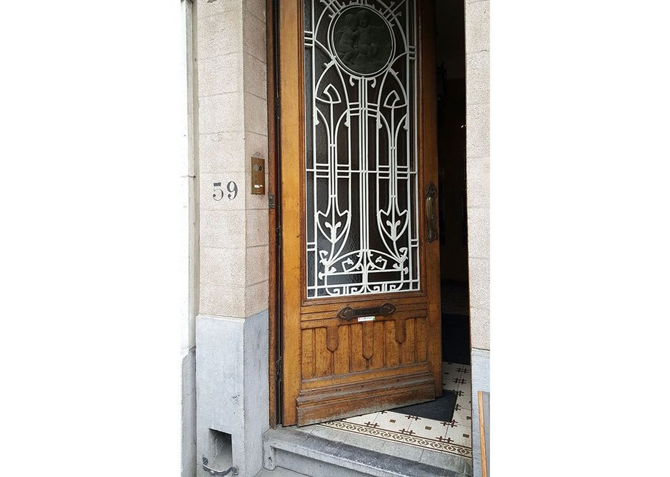 Entranceway to Maison Lefever, the personal home of architect Fernand Lefever, whose work is prolific in the area of Koekelberg. This house was built in 1913 on a grand boulevard planned by King Leopold II. Inside, the house has the typical 19th century maison de maître layout of three consecutive rooms beside a hallway and stair.