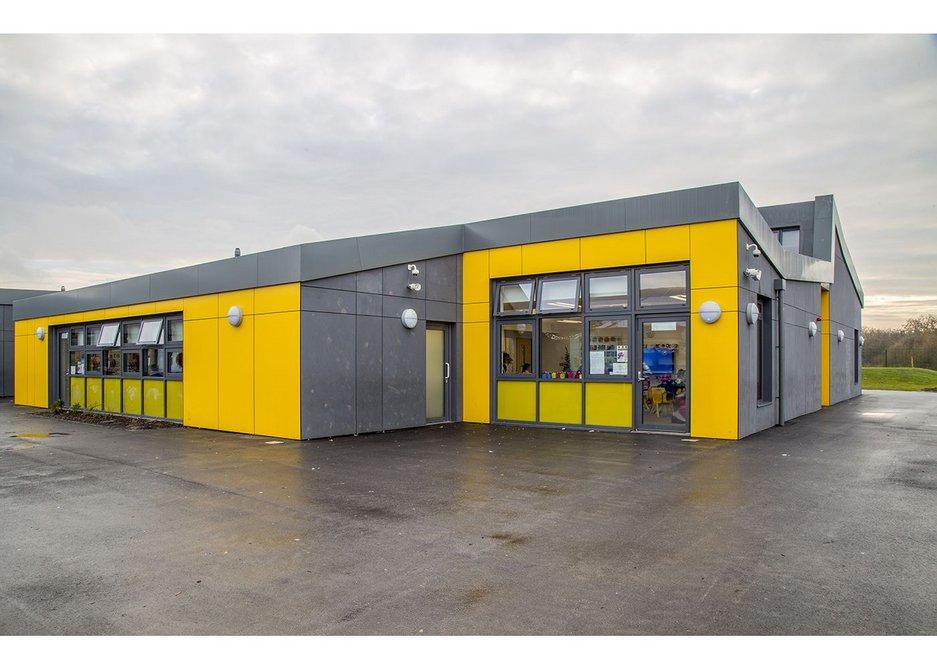 Yellow and grey Formica rainscreen cladding at Barrow Hall Primary School near Warrington, designed by Ellis Williams Architects.