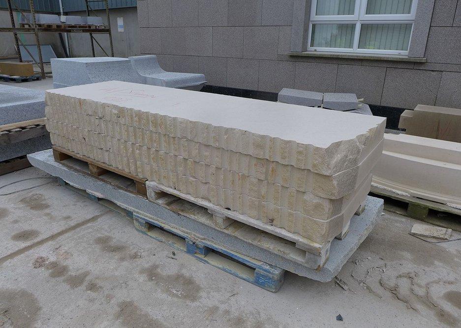 Rough cut stone panels cut from limestone block.