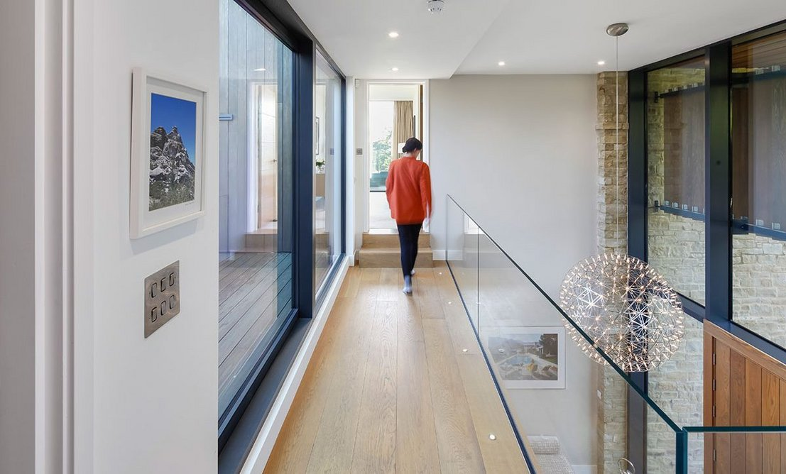 Large areas of glazing flood the entrance hall with natural light.
