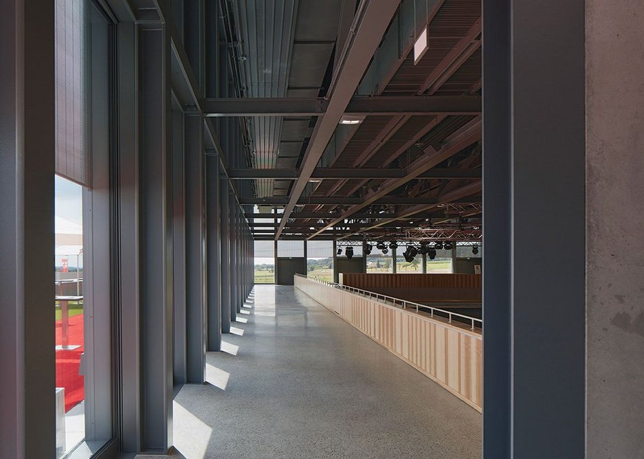 Steel columns at 2.7m centres generate the stoic rhythm of the events hall facade.
