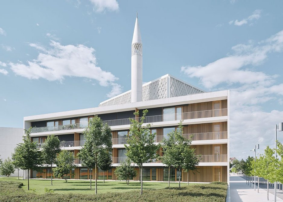 The scheme redevelops a large site to incorporate a mosque, religious school and library building as well as a cultural hub, office and, here, the residential building for the community's employees.