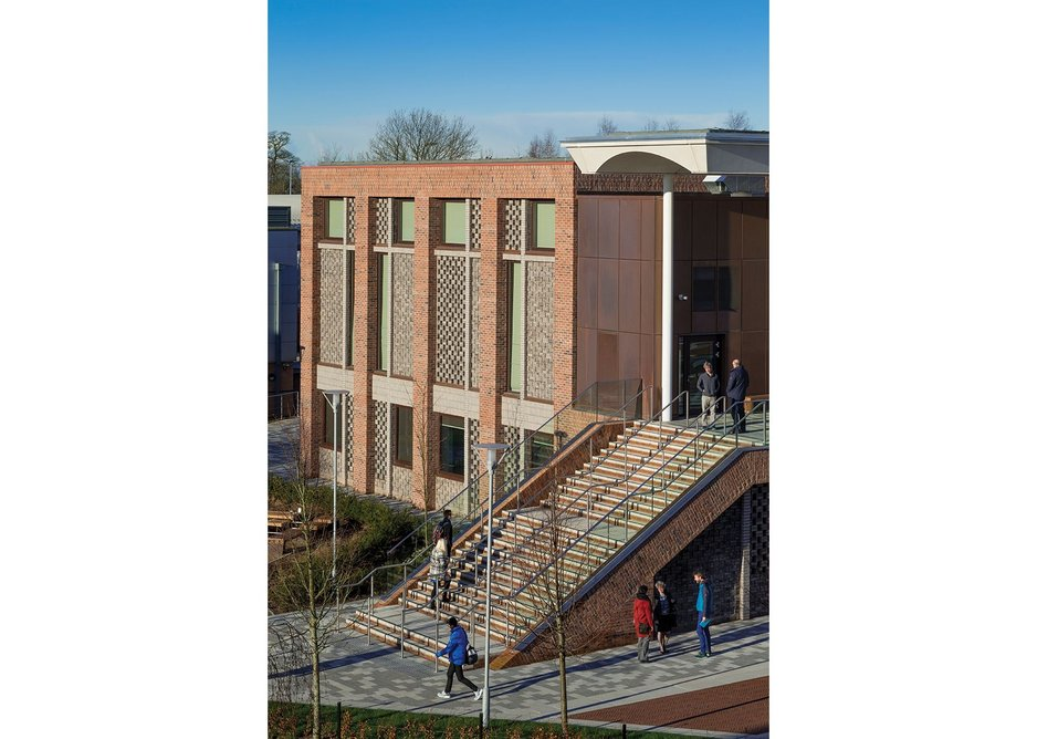 Side and rear elevations of the teaching block are exercises in textural and perforated brickwork.