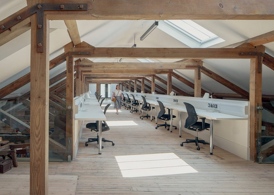 An inserted mezzanine has rentable workspace for designer-makers on the third floor.