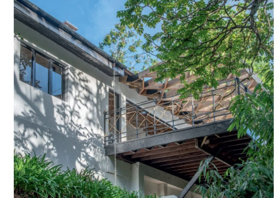 The extended house expands over and out into the garden's tree canopy, establishing a direct – and exciting – relationship with the surrounding landscape.