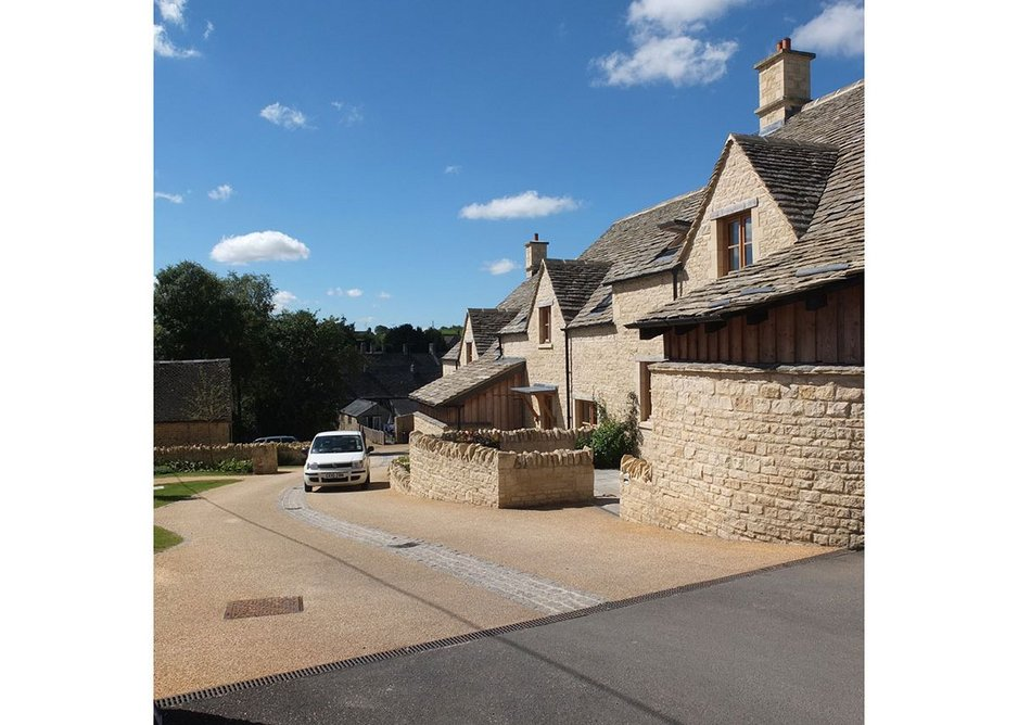 Low limestone rubble walls and gentle landscaping give the close an appealing feel. MacEwen Award shortlisted Sly's Close, Northleach, Gloucestershire. Mungo Park Architects