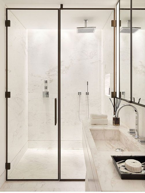 Show flat master ensuite, featuring Greek Galaxy floor and wall tiling from Campolonghi, and metal detailing to shower screen and cabinets.