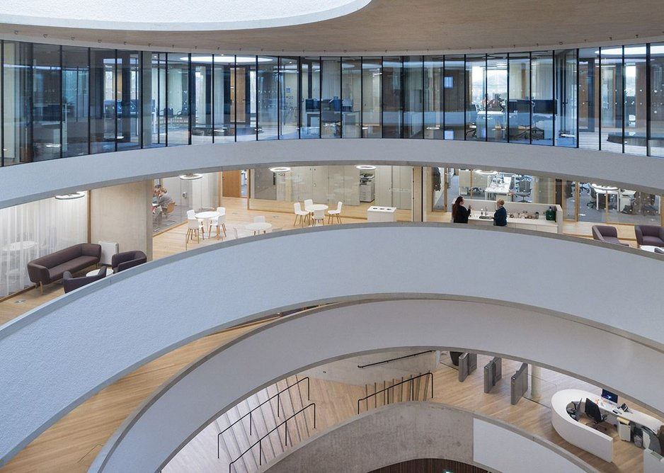 Above the first floor and no longer part of the vertical circulation, the spaces around the circular voids feel 'left over' and contingent.