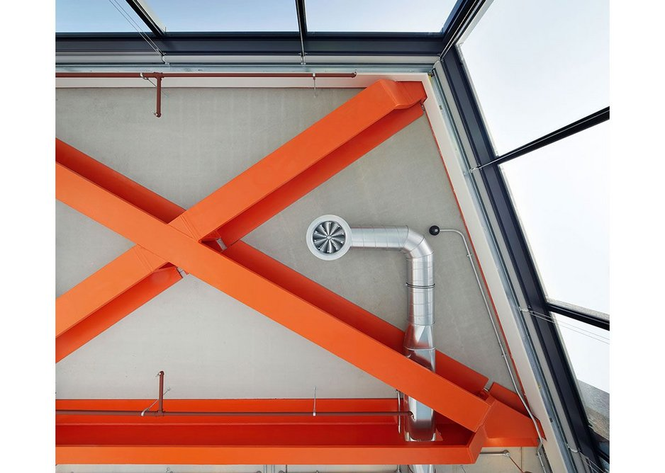 Corner cantilevers have their structure boldly highlighted in the Brunel Building's signature orange. Services slip in neatly between.