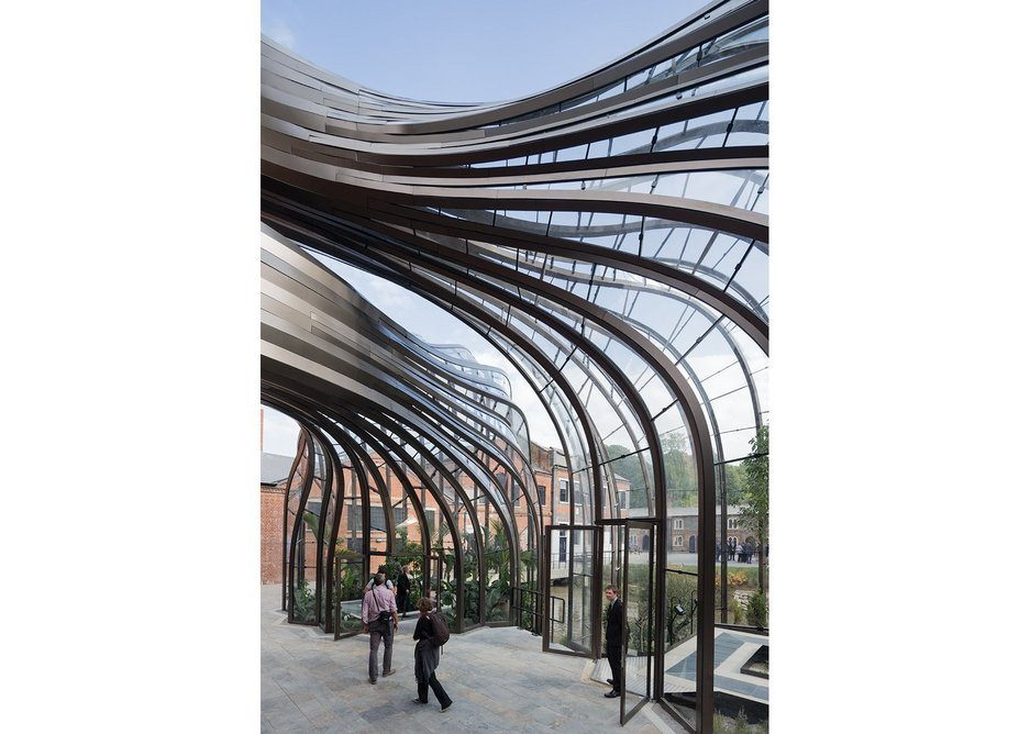 The twisting geometries of  the glass houses give a heady,  delirious effect