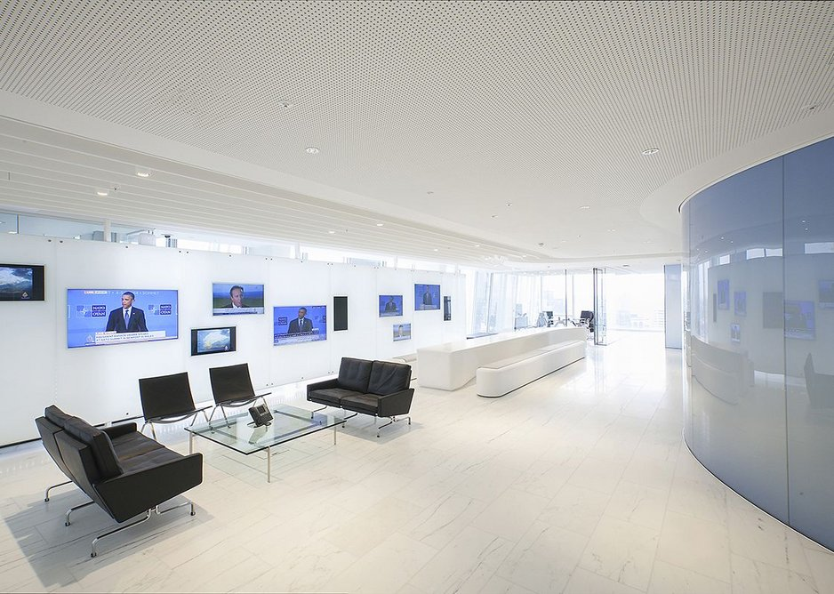 Media wall in reception, offices on the outside of the plan, control room in the core
