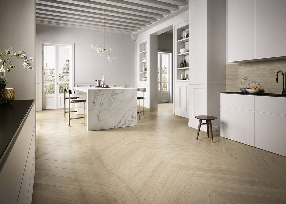 Kitchen and dining space with Anima Select Bianco Arabesco counter and Fabula Robur Chevron floor