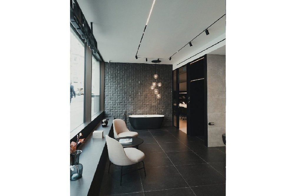 An ambient bathroom setting on the ground floor of the Porcelanosa design centre with Krion bathtub.