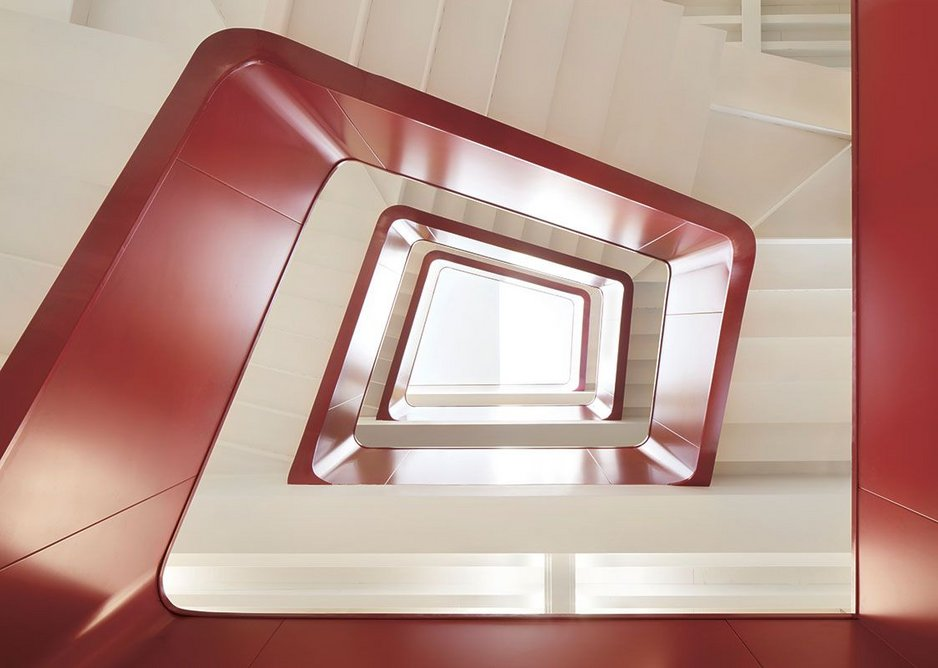 The finely detailed steel plate stair is a dynamic addition to the space.
