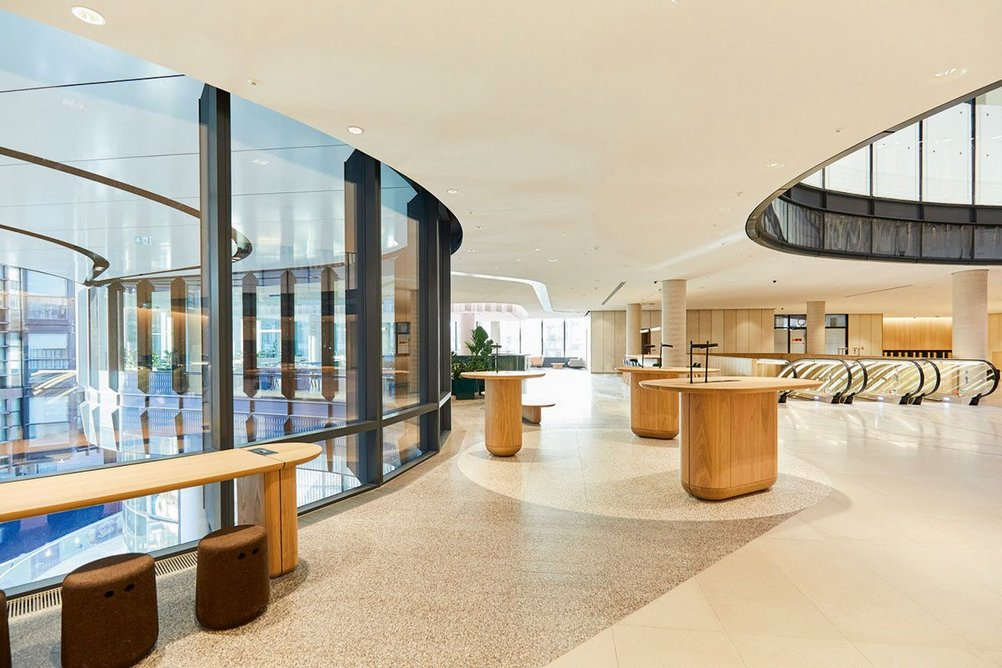 The second-floor reception area sits at the base of the atrium and overlooks the west entrance to Octagon Mall and Broadgate Circle through a curved glazed facade.