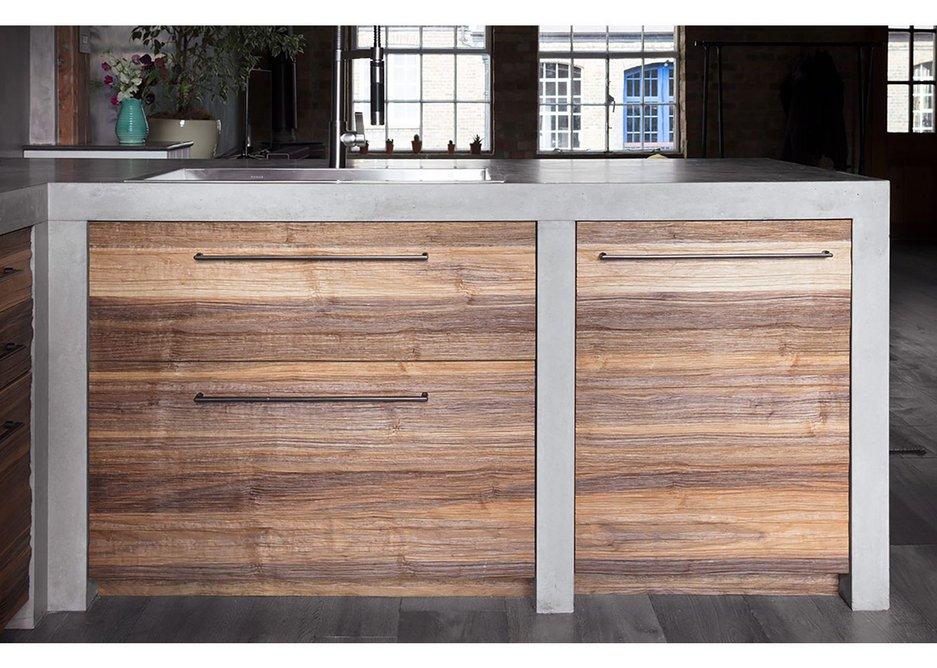 A Roundhouse 'metro' bespoke kitchen in river-washed walnut ply and cast-insitu concrete work surfaces.