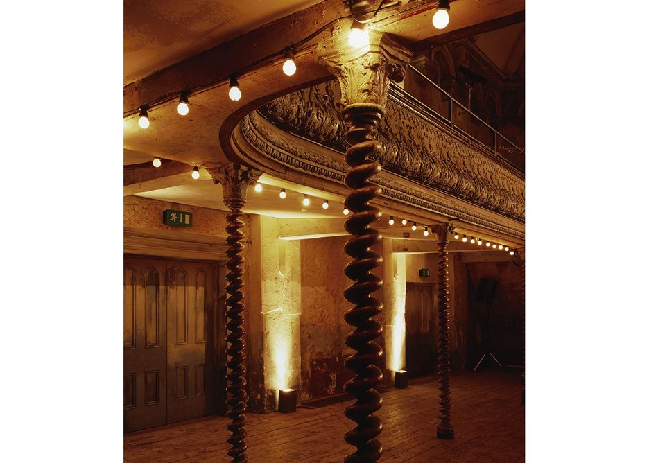 The auditorium with its coiling iron gallery columns is a very rare survival of the old East End.