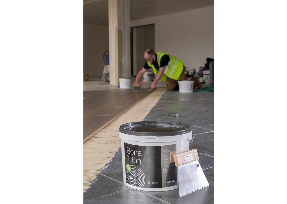 Bona Titan silane-based adhesive for wood floors.