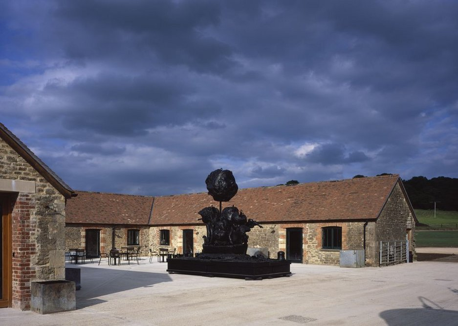 A piece of sculpture enlivens an outdoor courtyard