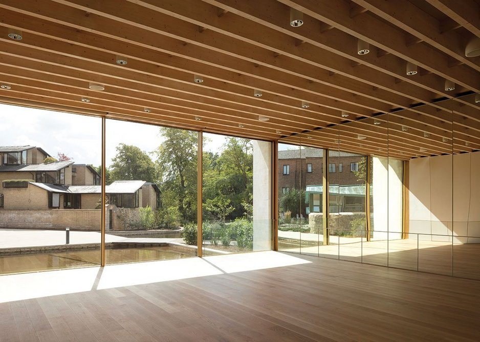 Glulams in the studio give a sense of enclosure despite the large expanse of glass and mirrors.
